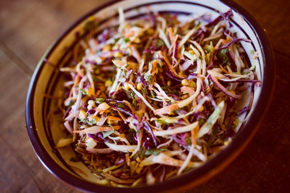 vegetable salad on white and black ceramic bowl