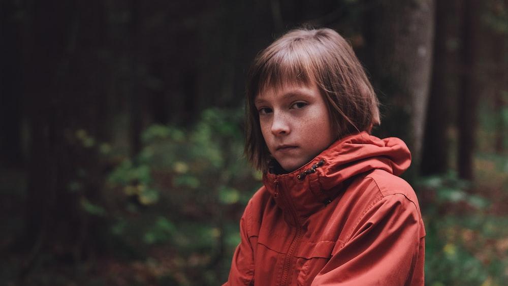girl wearing red hooded jacket
