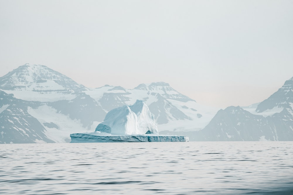 iceberg near mountain