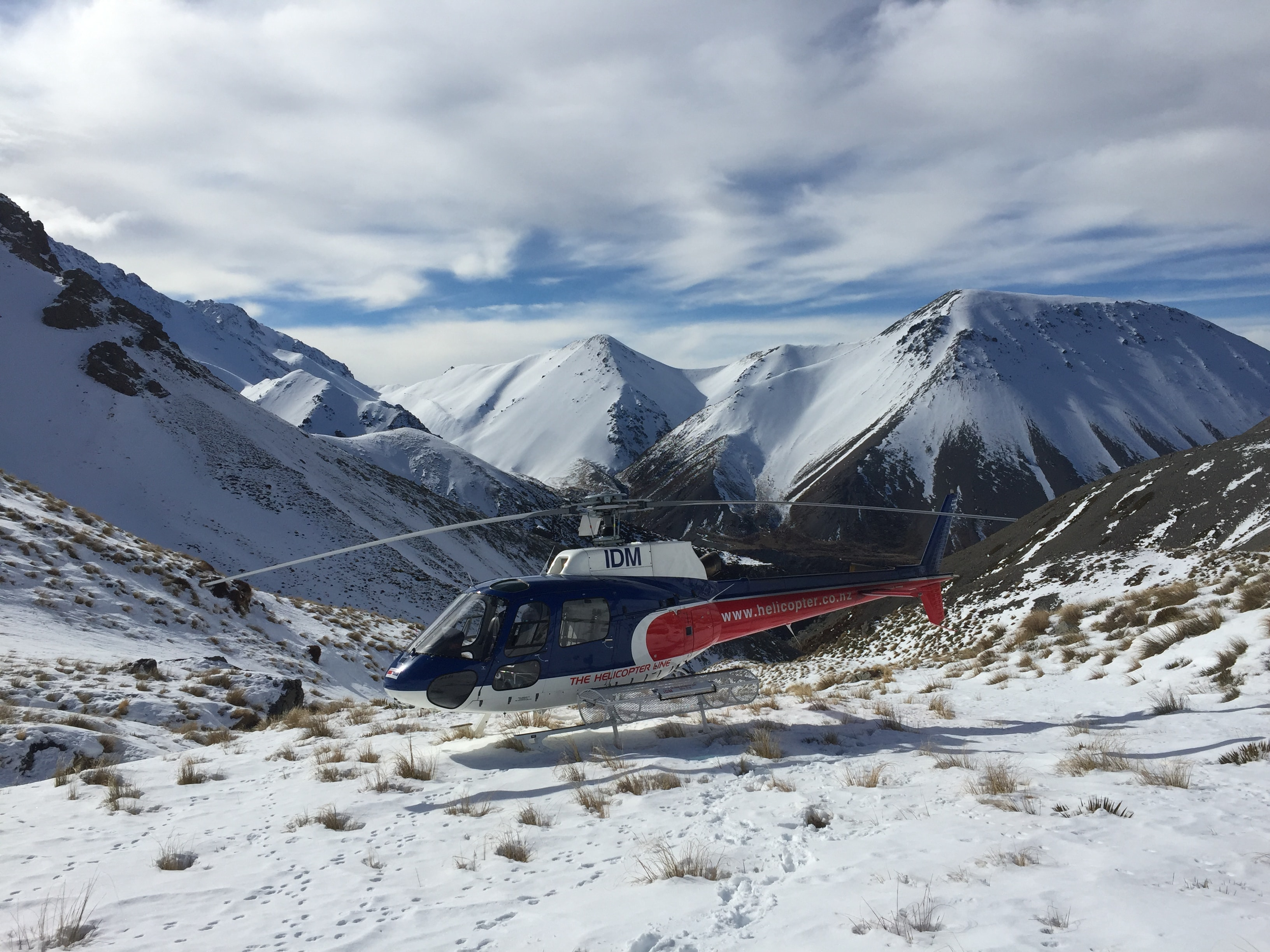 black and red helicopter on mountain