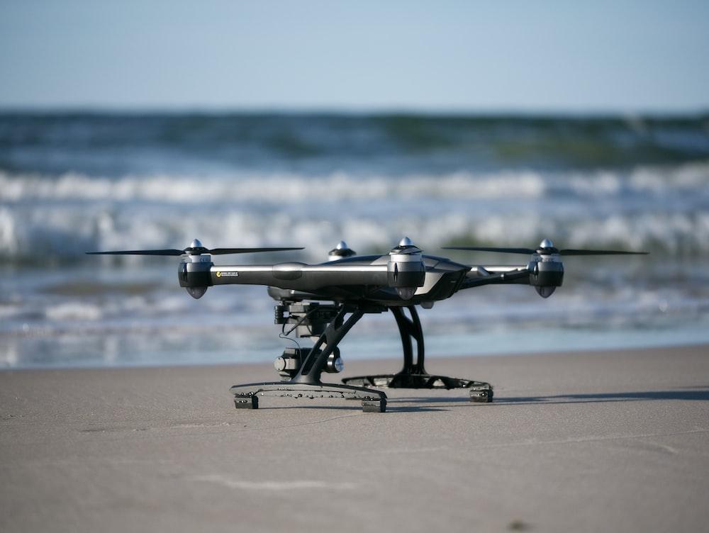 gray drone near beach