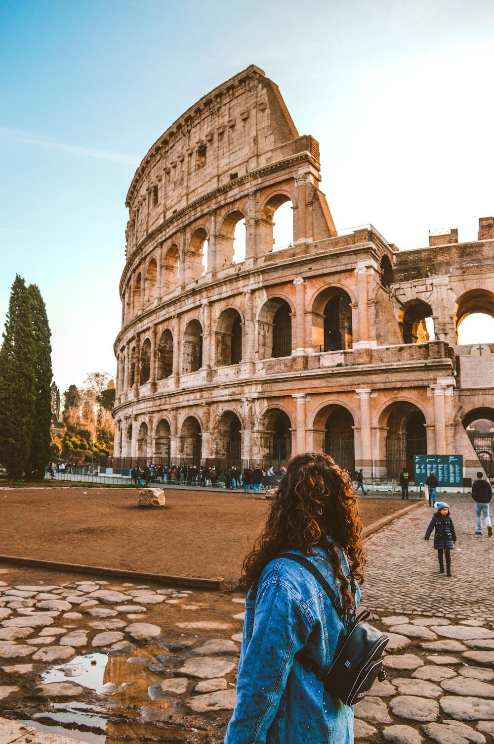 woman standing near Colosseum, Rome