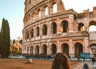woman standing near Colosseum, Rome