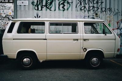 beige van parked on street