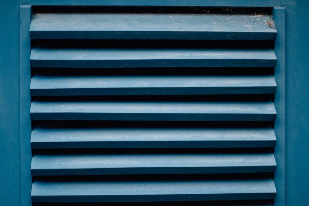 blue wooden window vent