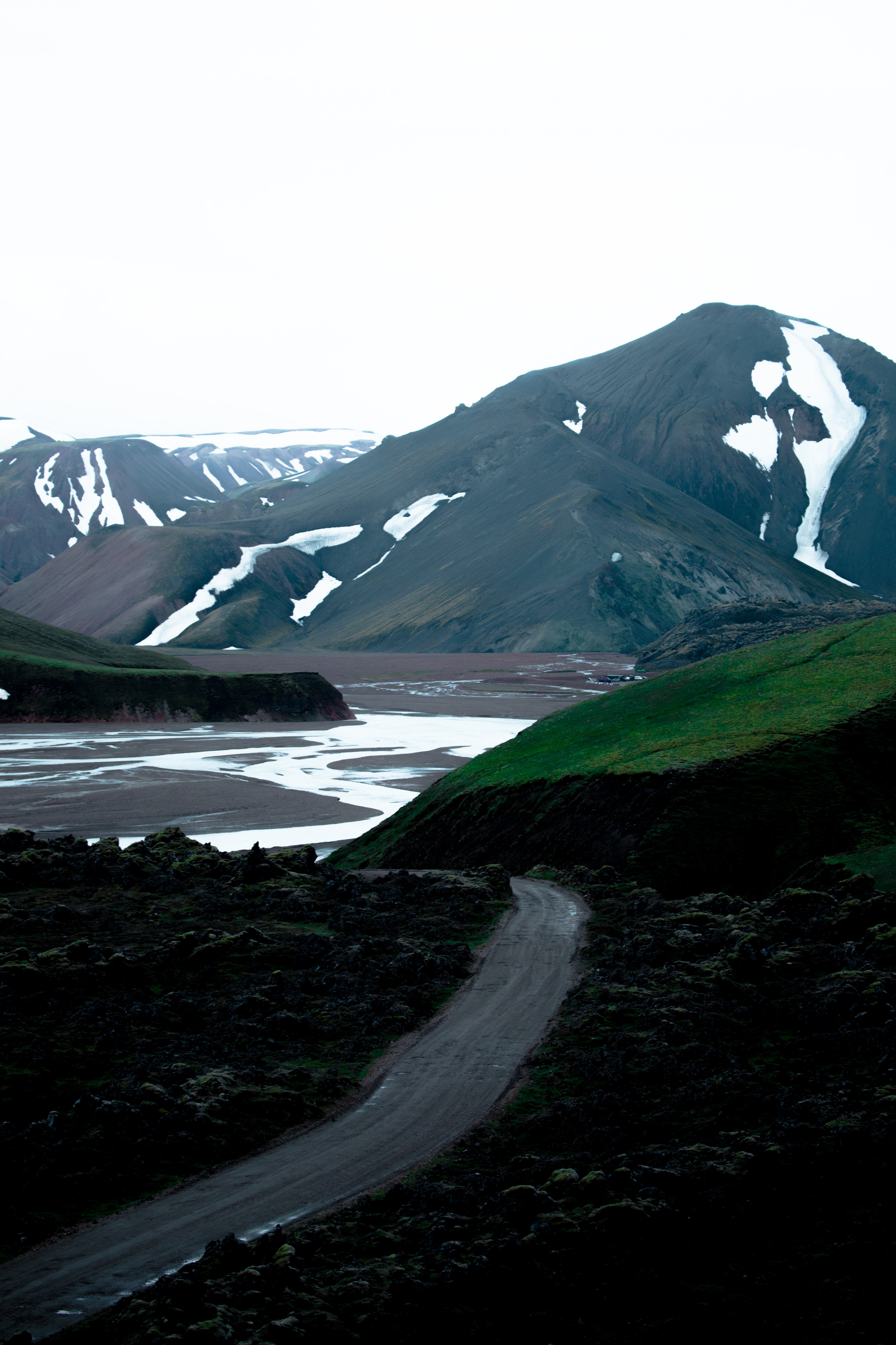 road near across mountian during daytime