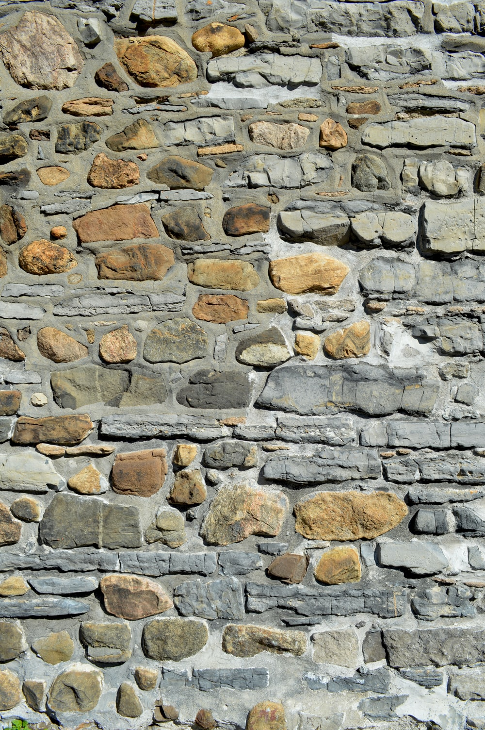 brown and gray stone wall