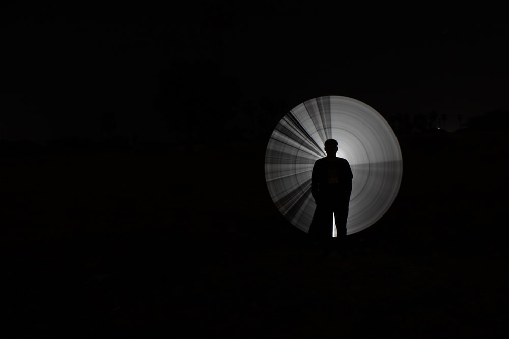 person standing with light reflection