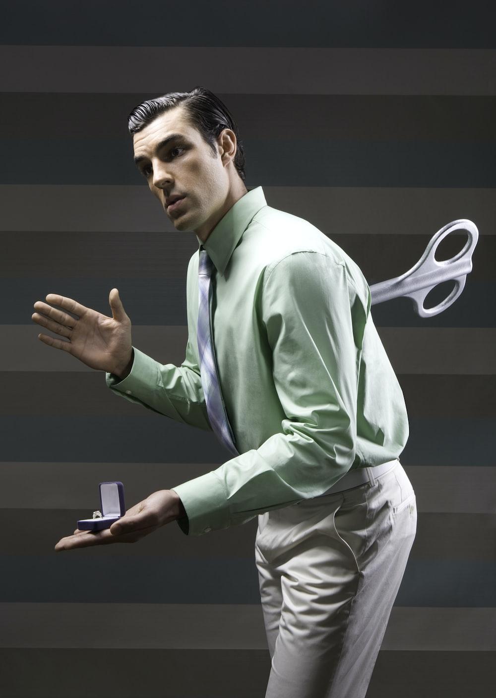 man wearing suit jacket clockwork toy