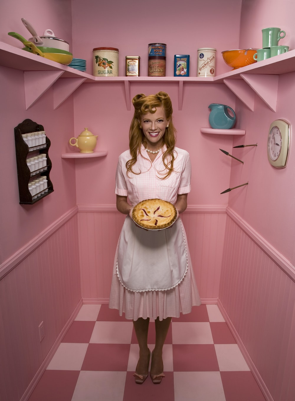 woman holding pie in storage room