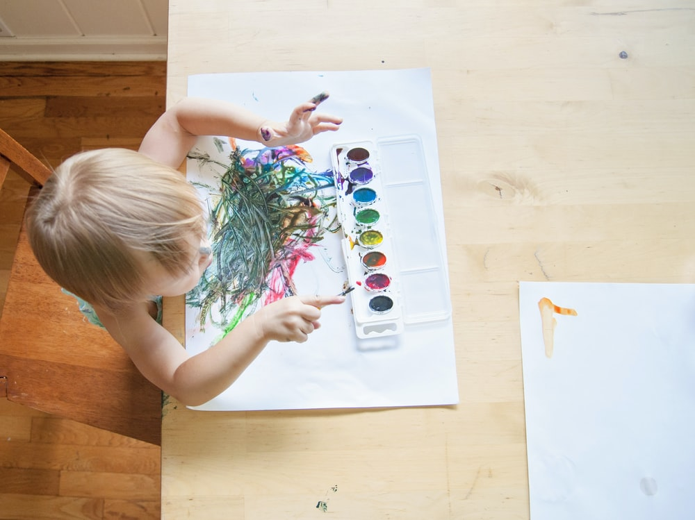 toddler painting on white paper