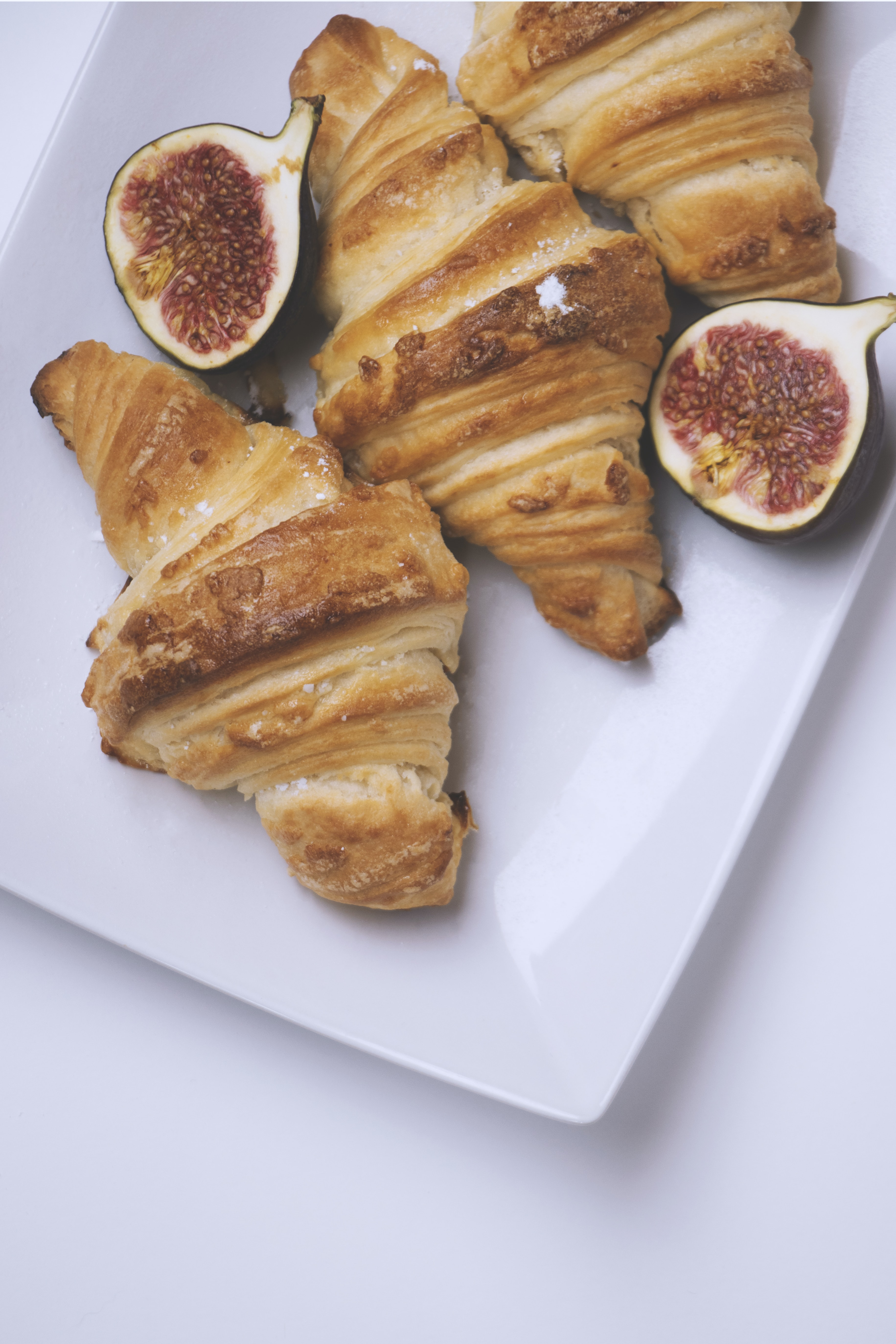 three croissant bread on white plate