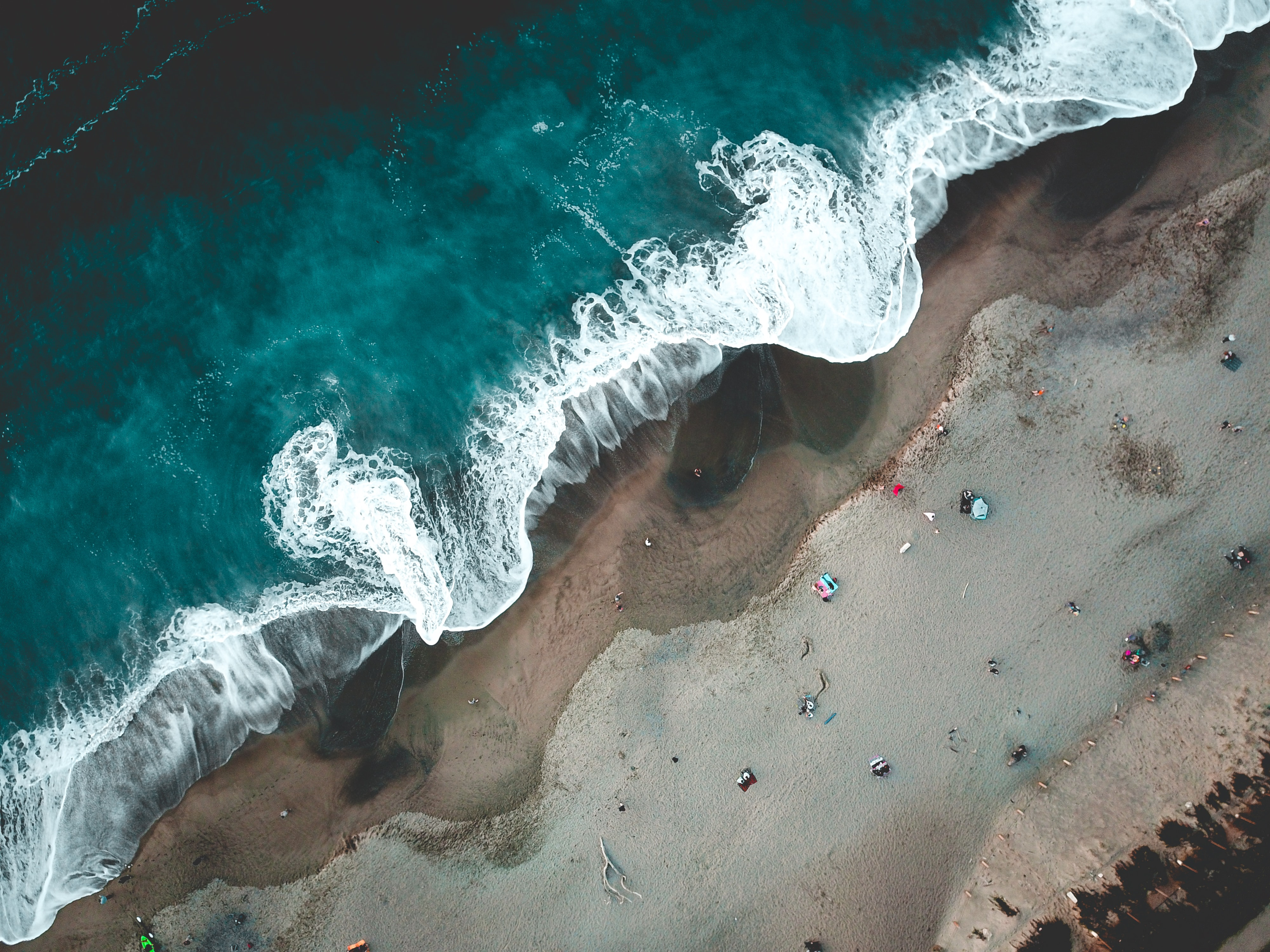 aerial photography of tidal wave and sand