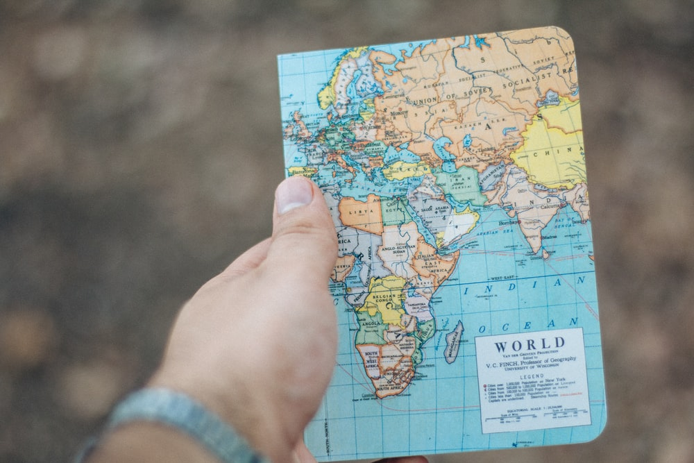 person holding world map