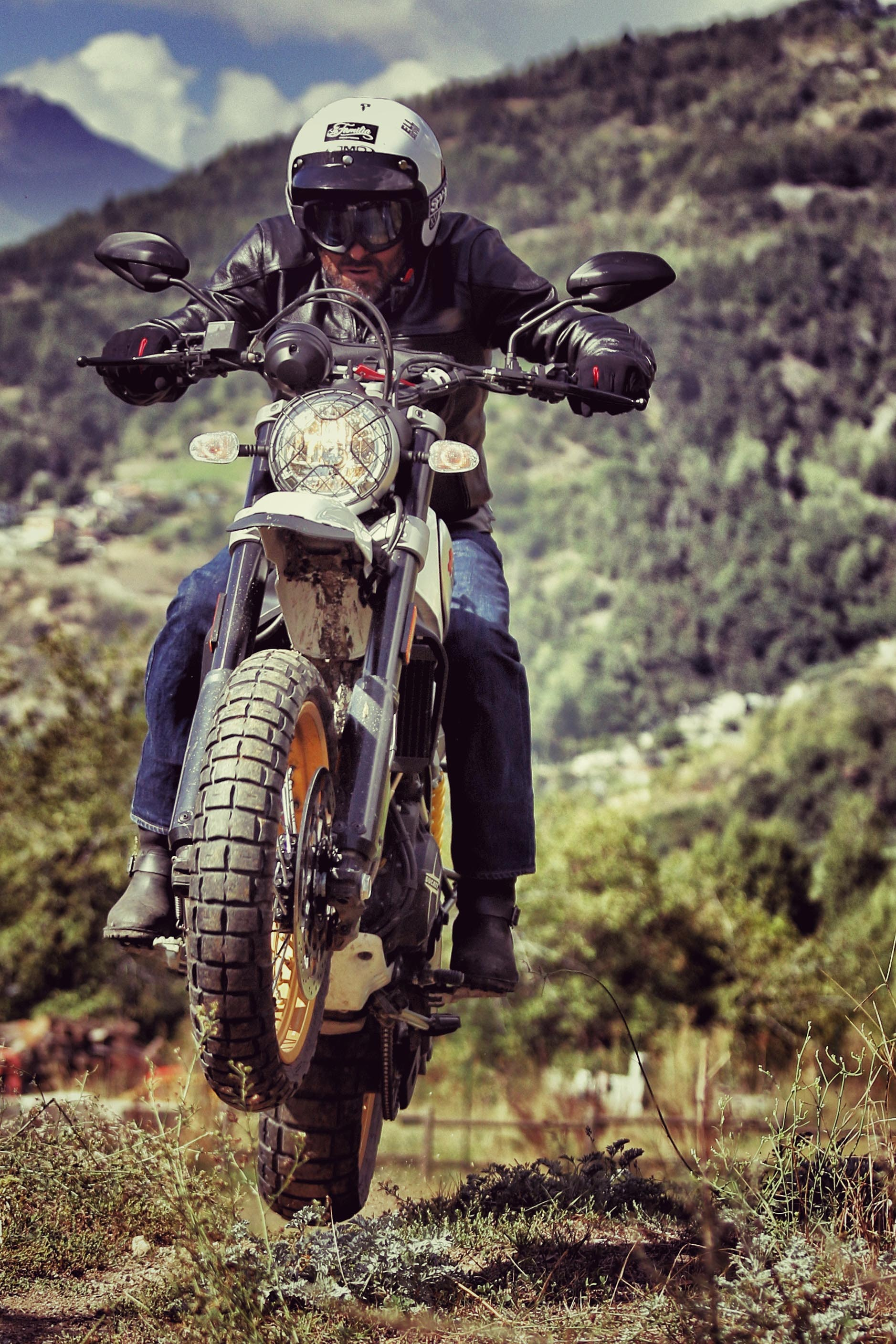 close-up photography of man riding motorcycle during daytime