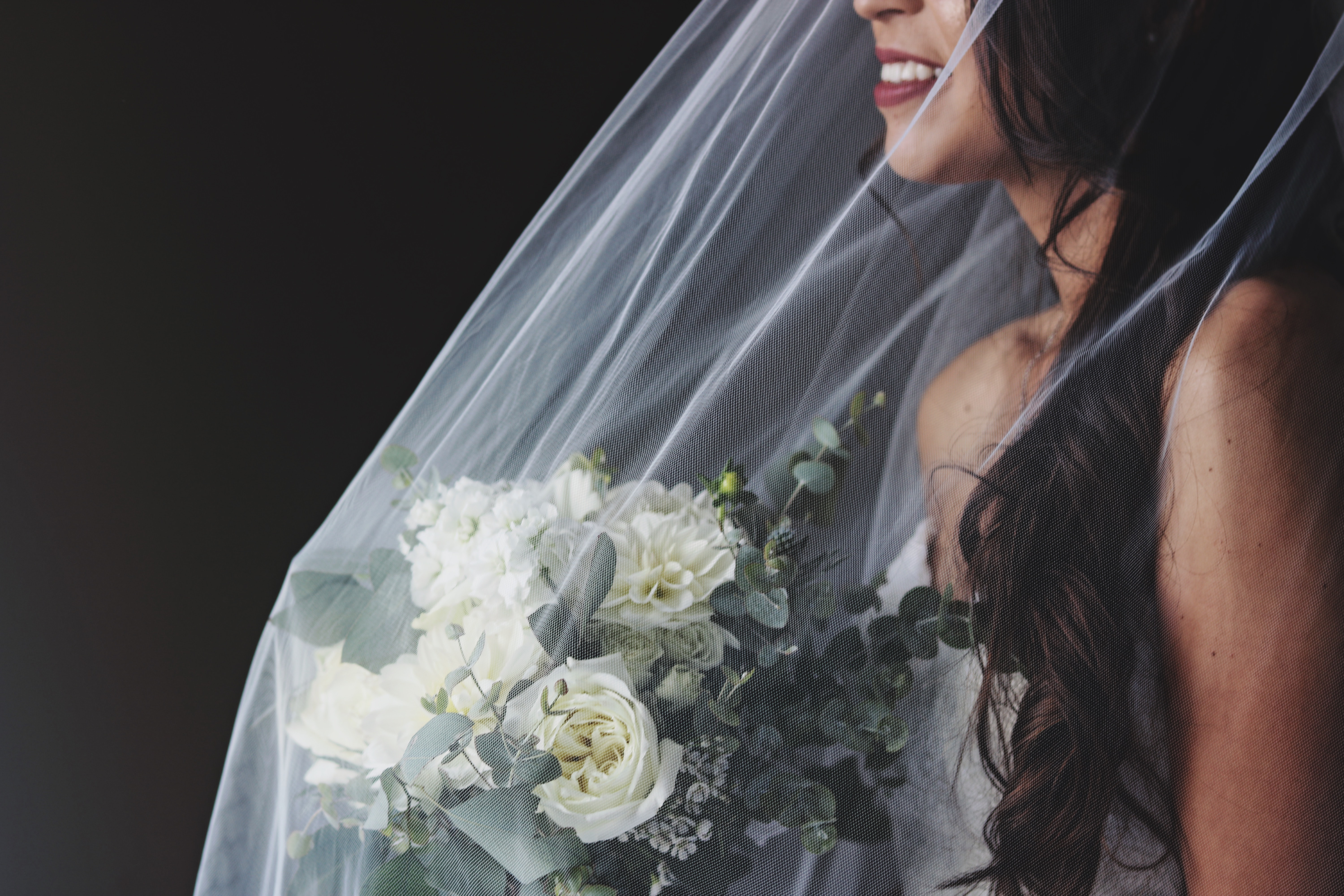 bride holding flower bouquet