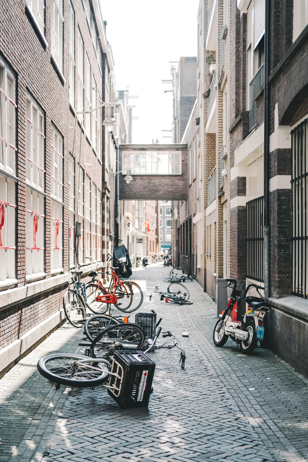 parked bicycles between concrete buildings