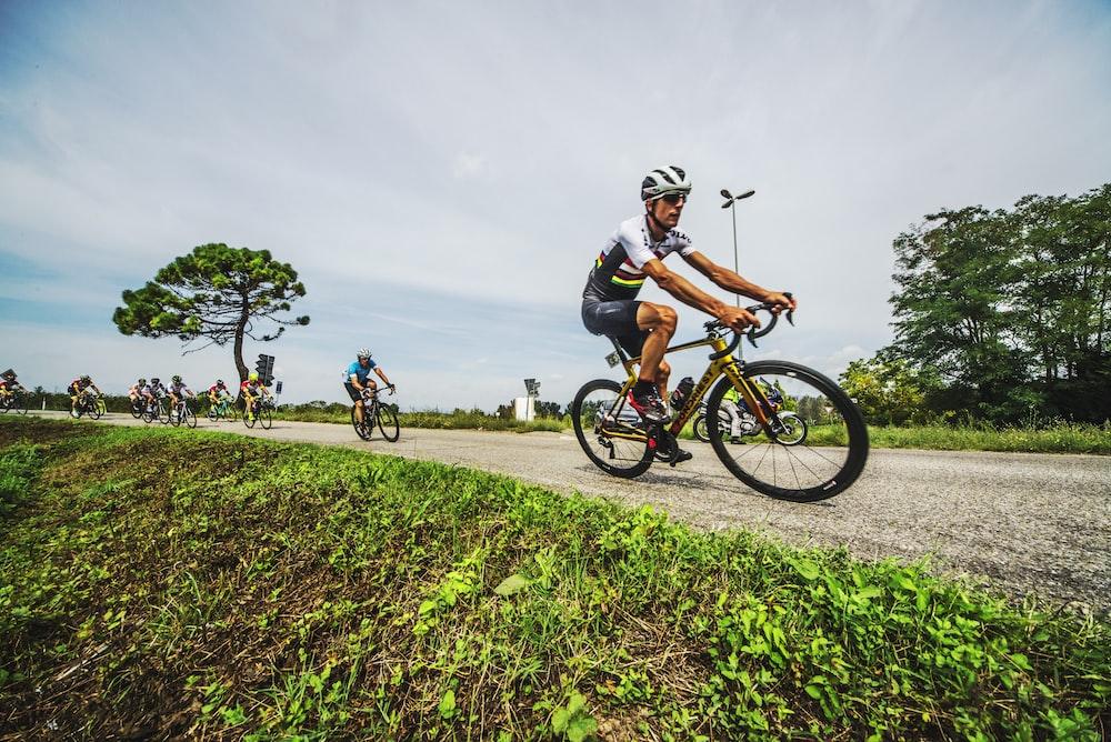 group of men biking on dirt road