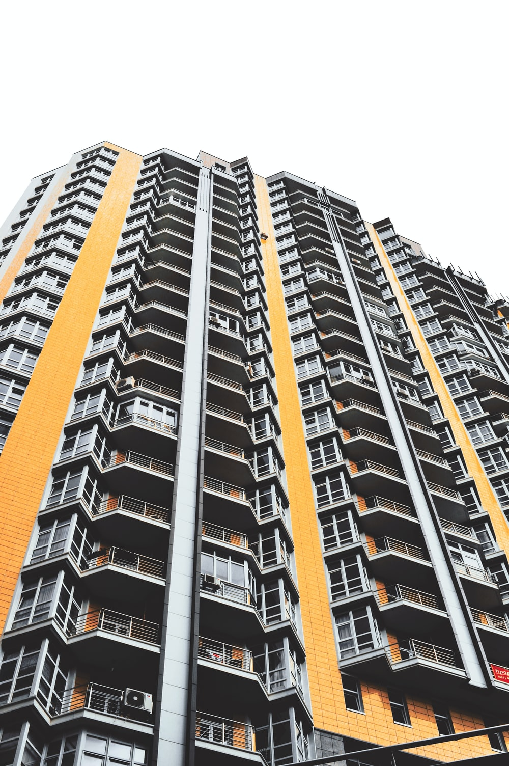 gray and orange concrete high-rise building
