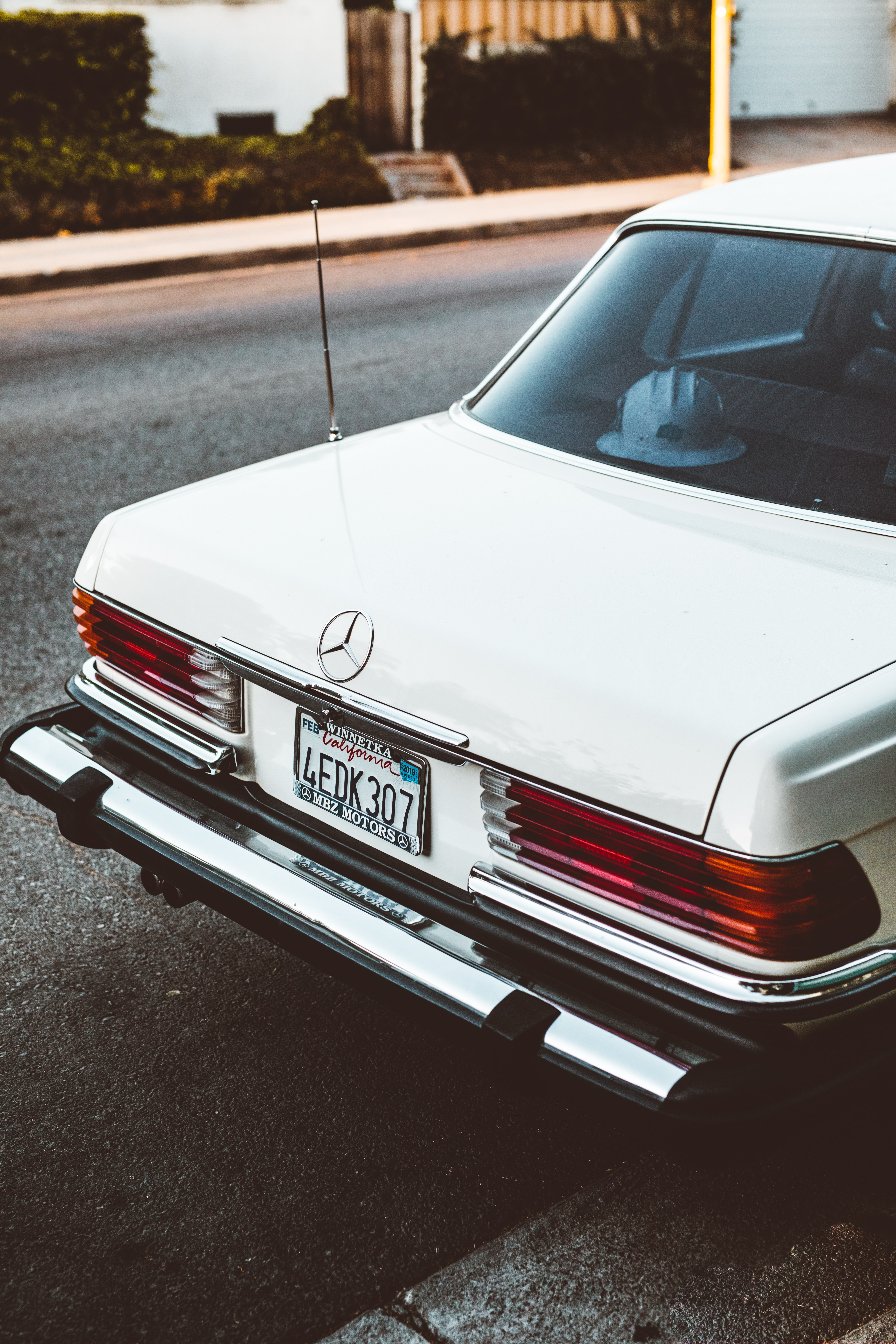 white Mercedes-Benz car parked on road