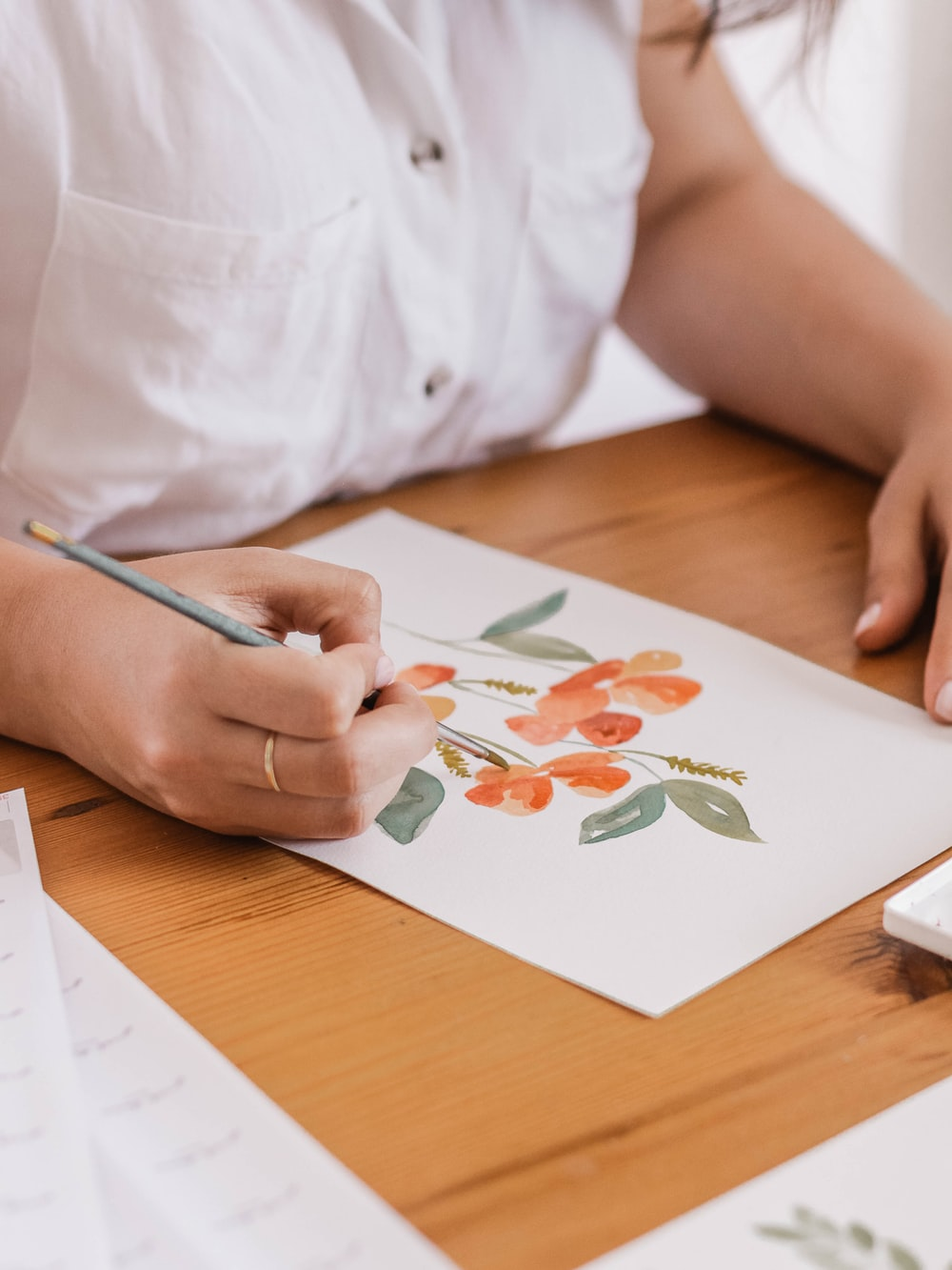 woman holding paint brush