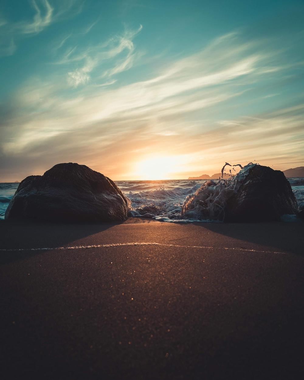 two rocks in seashore