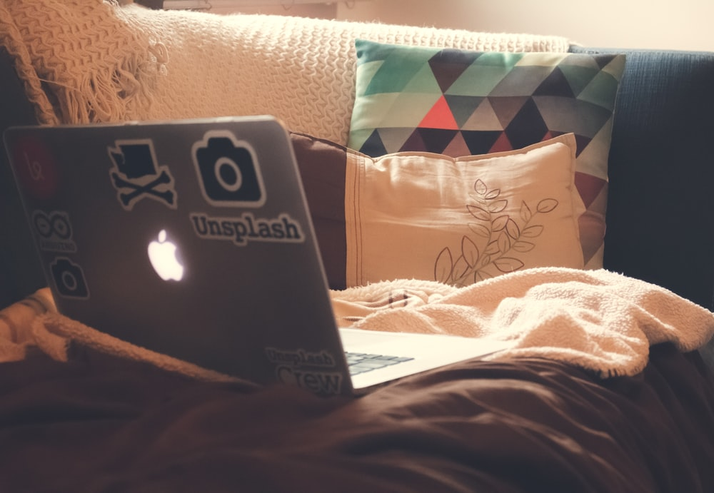MacBook Air on top of sofa