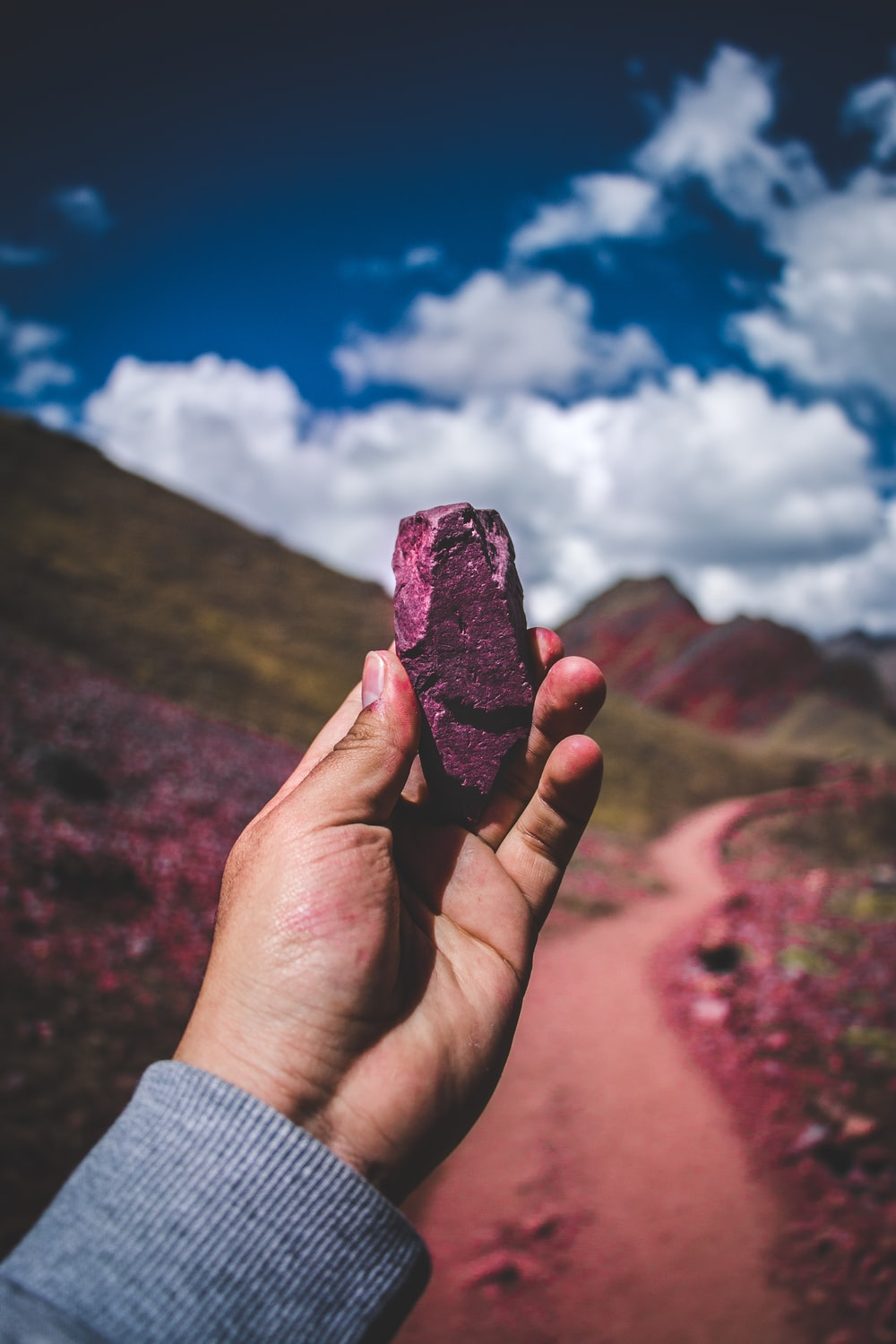 person holding pink stone
