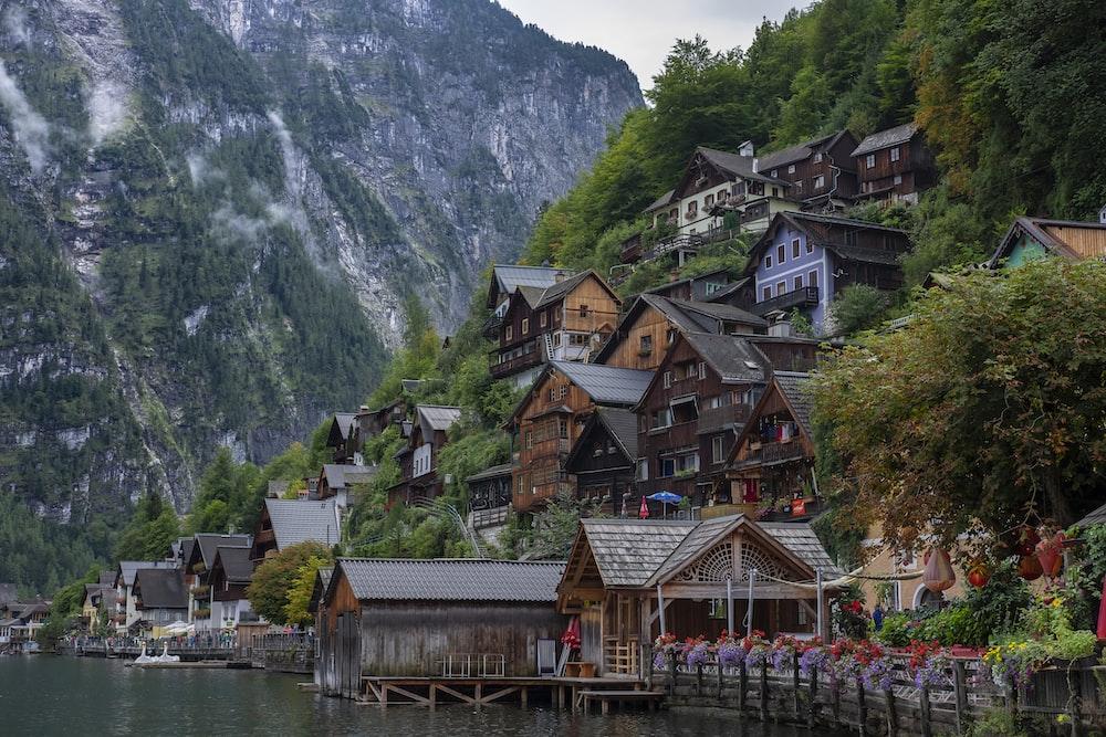 brown wooden village beside of body of water