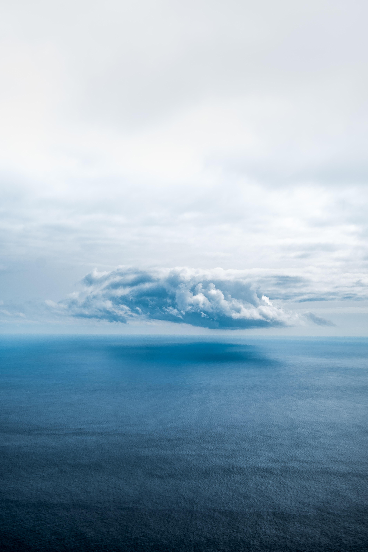 white clouds above sea