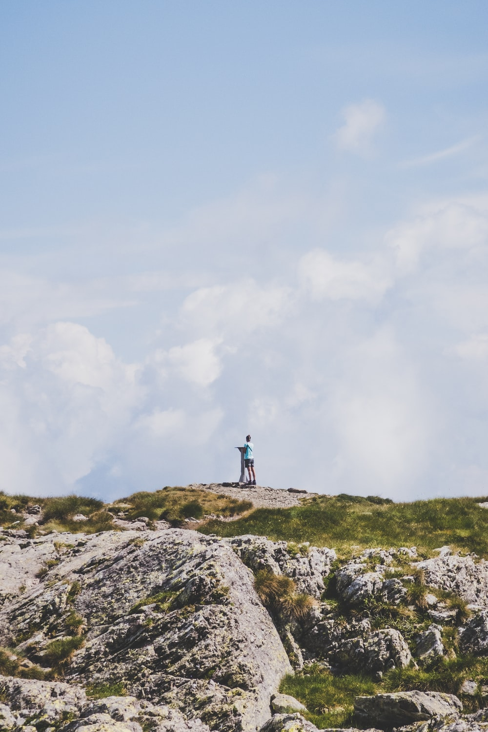 male and female standing on mountain