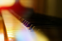 selective-focus photography of piano