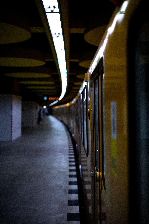 yellow train on rail