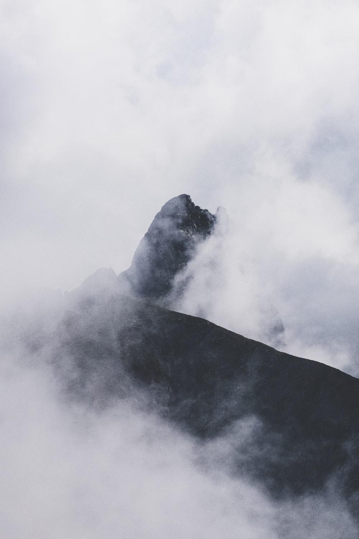 black mountain and white fog