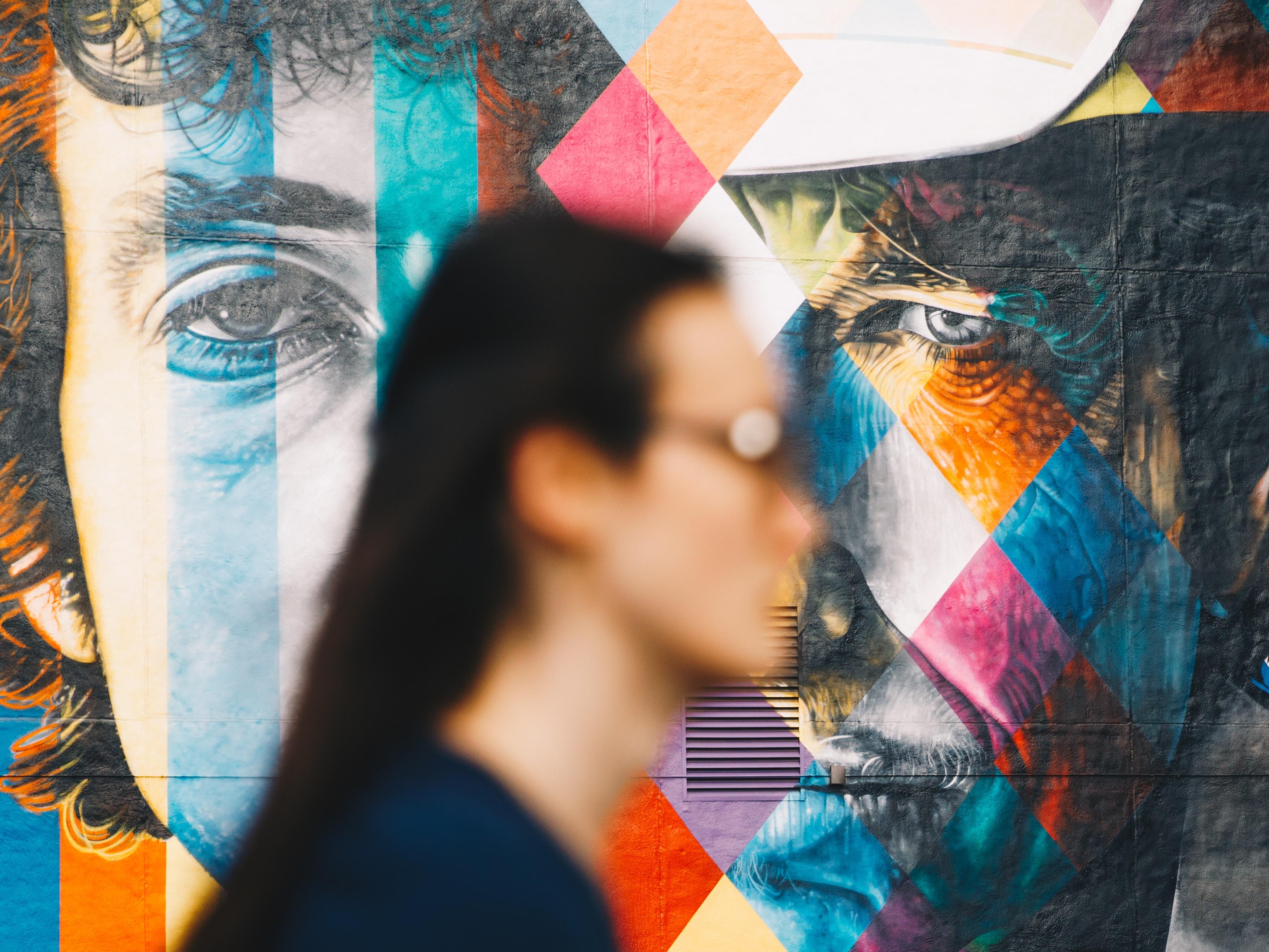 selective focus photography of man face wall art