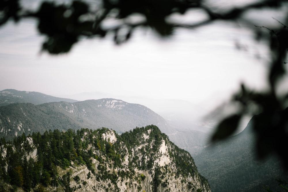high angle photography of misty mountain terrain