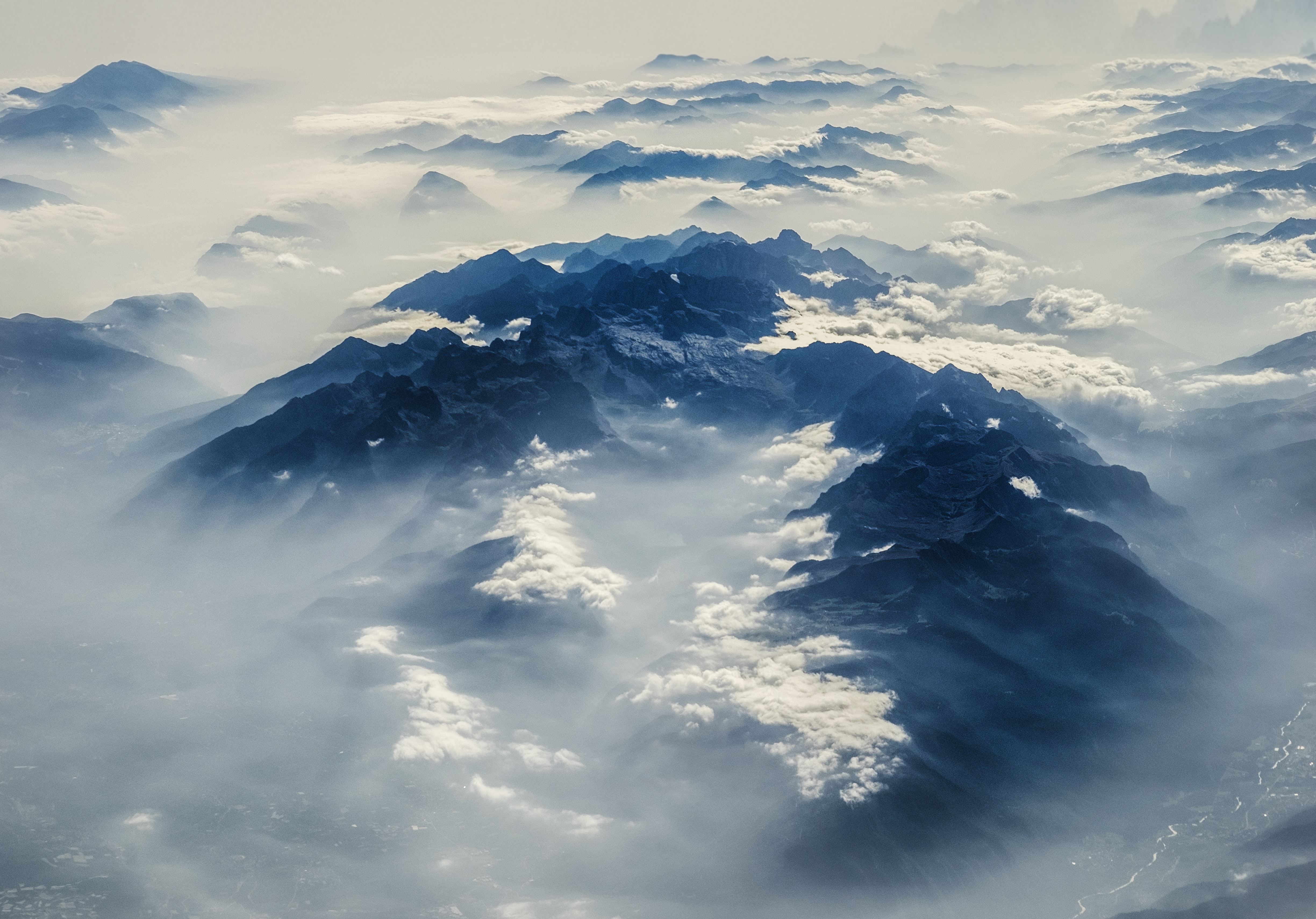 aerial view of mountain surrounded with clouds