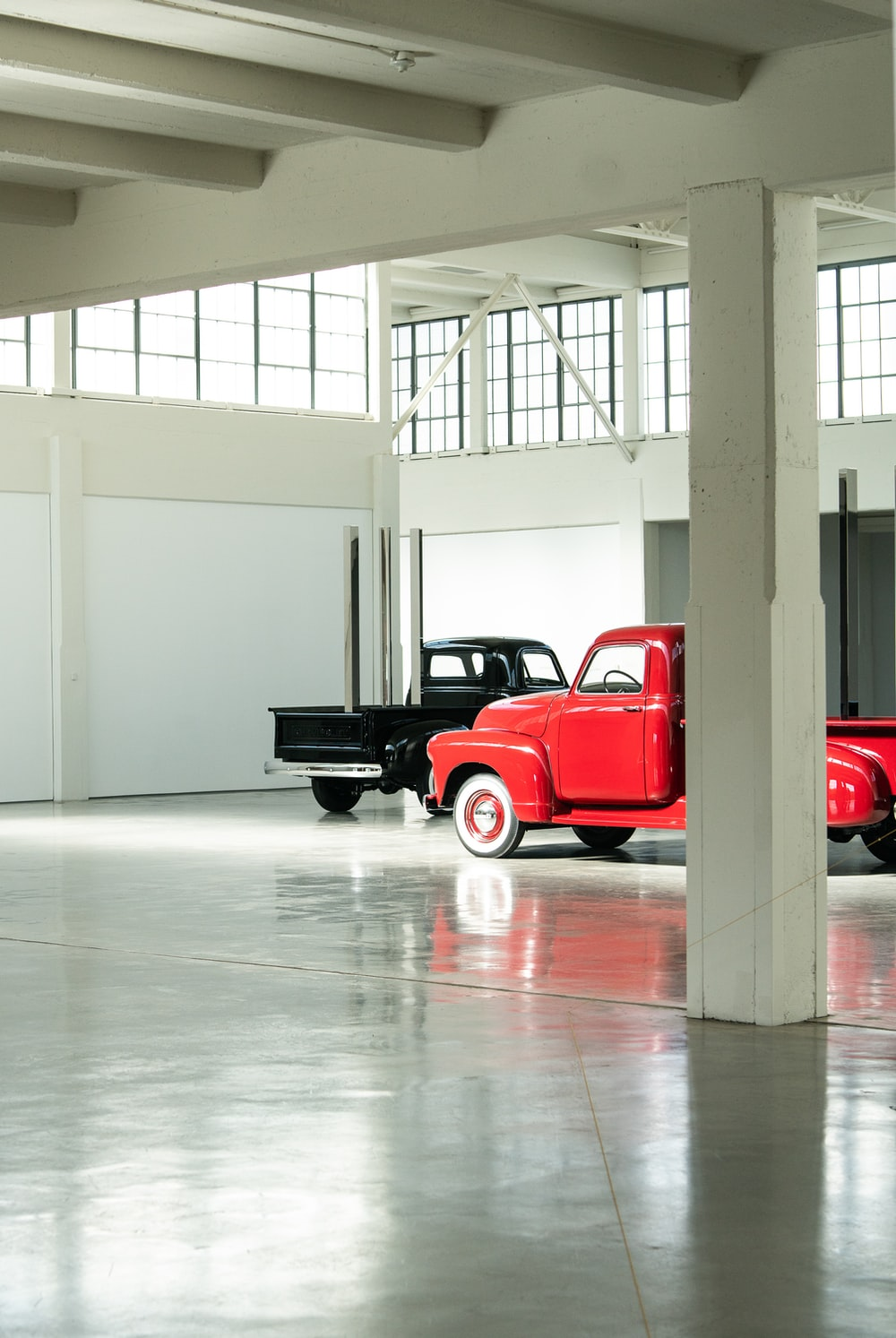 two parked red and black pickup trucks