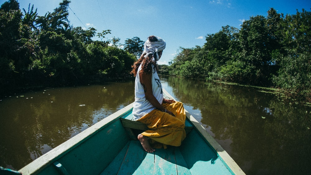 woman riding on boat at river