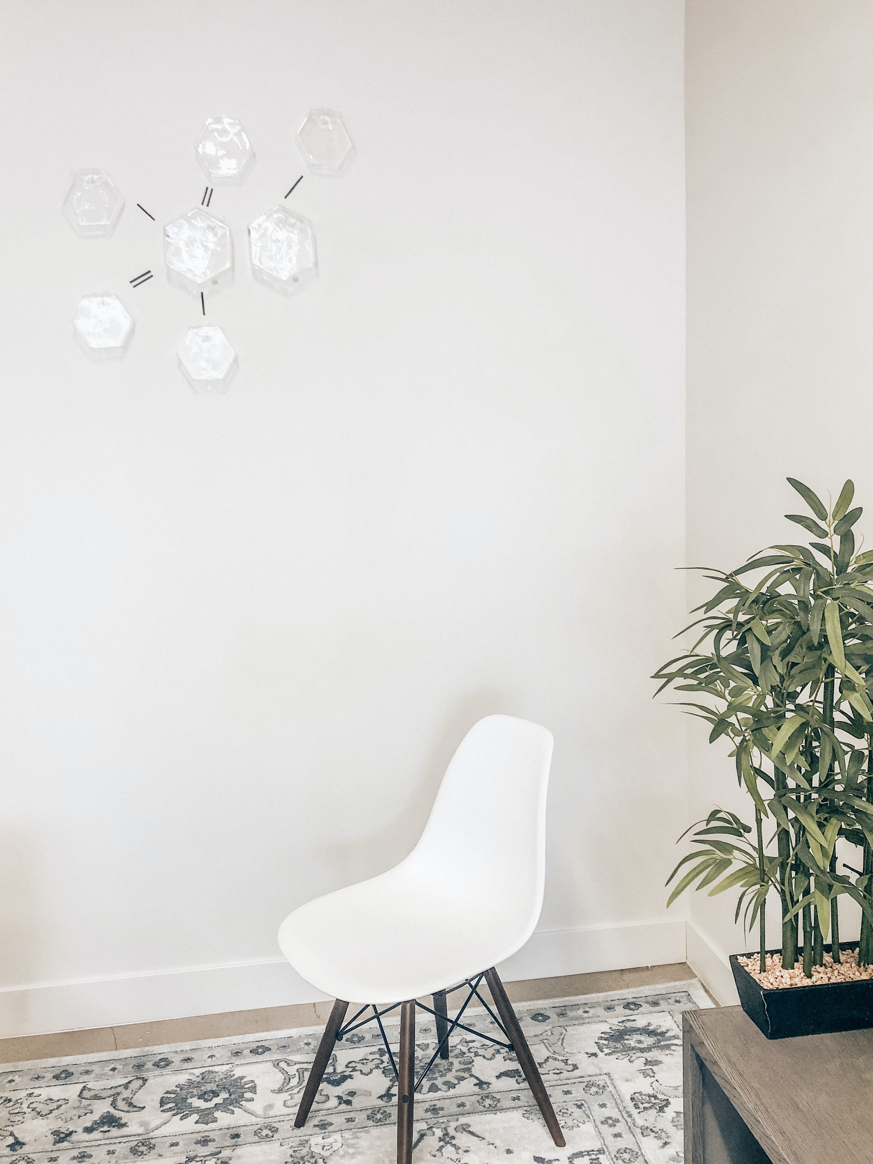 white and brown metal chair beside table