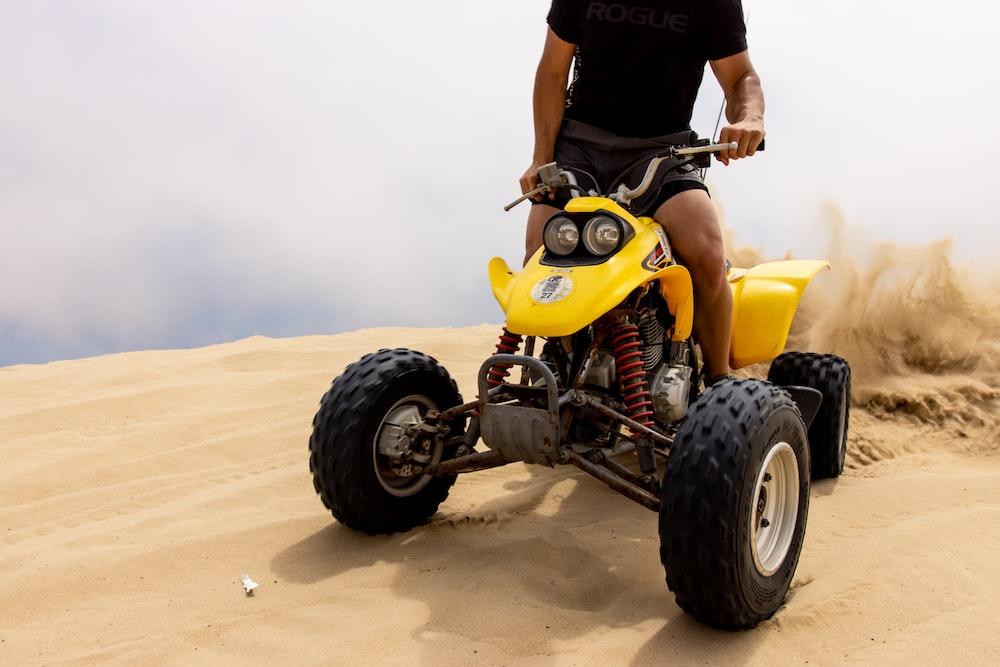 person riding ATV on desert