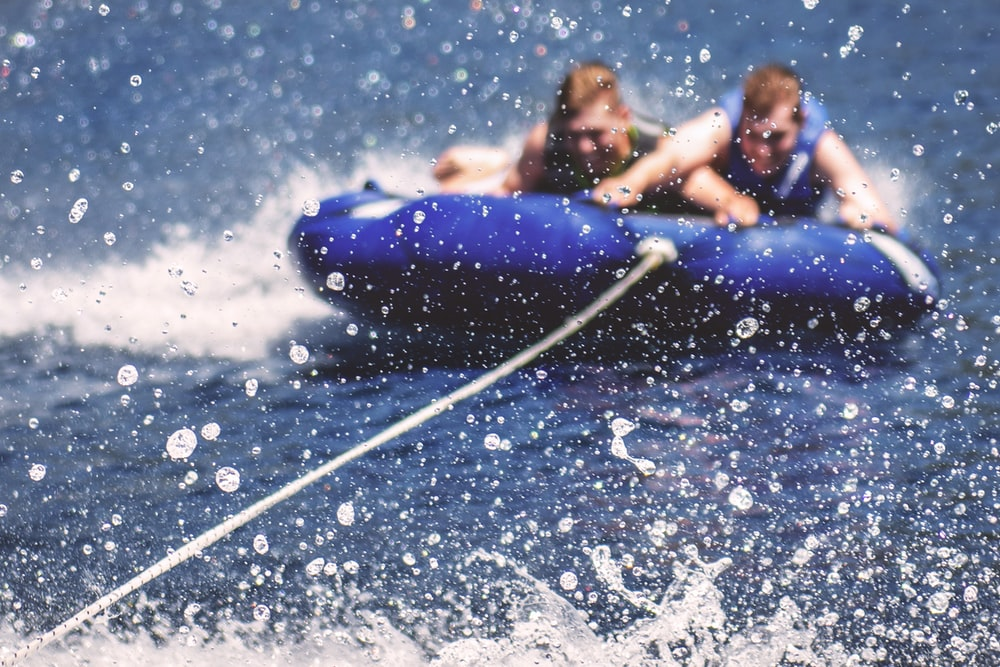 two men riding on inflatable boats
