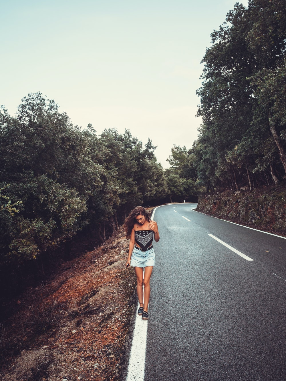 woman standing on road during daytime