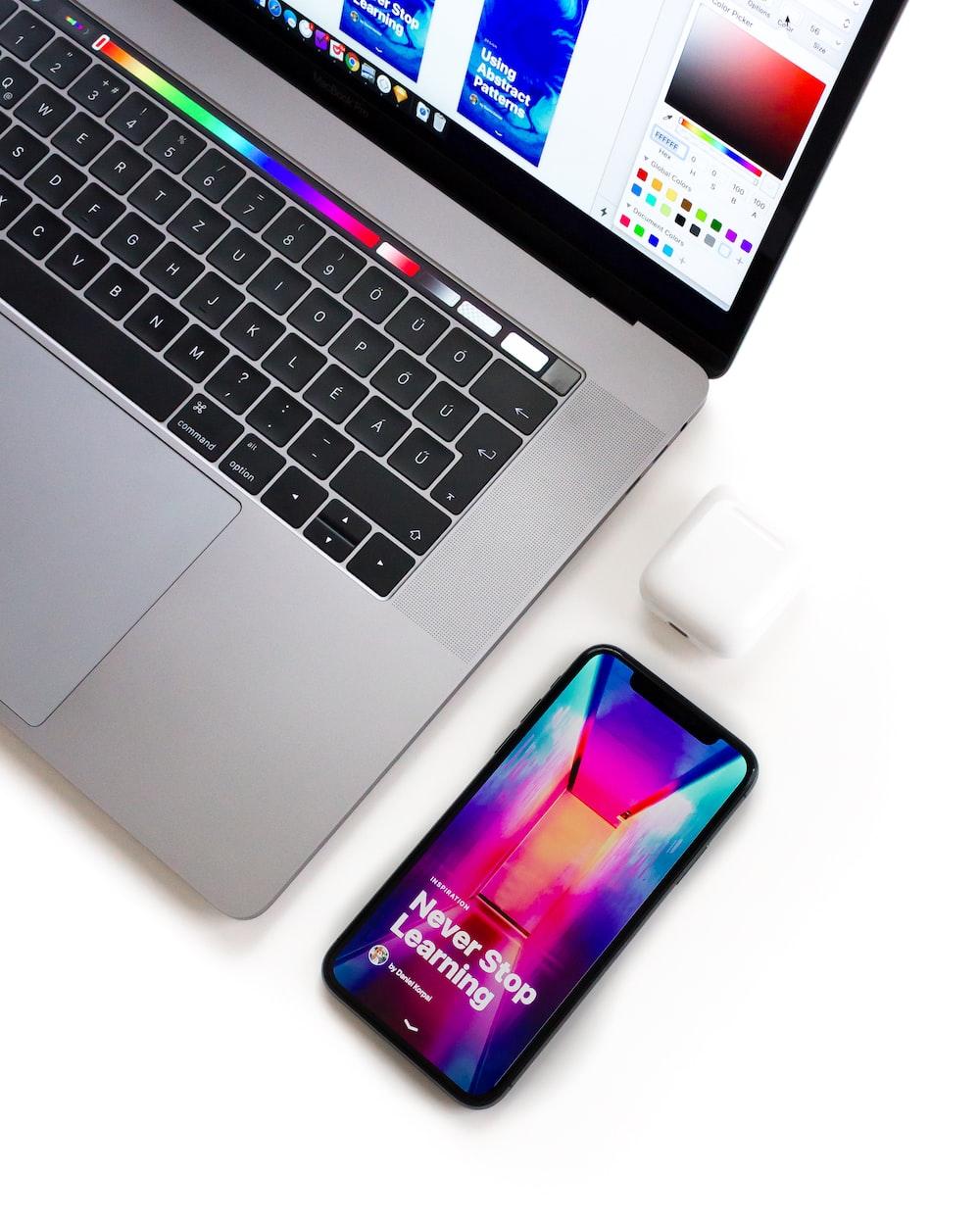 laptop near the smartphone