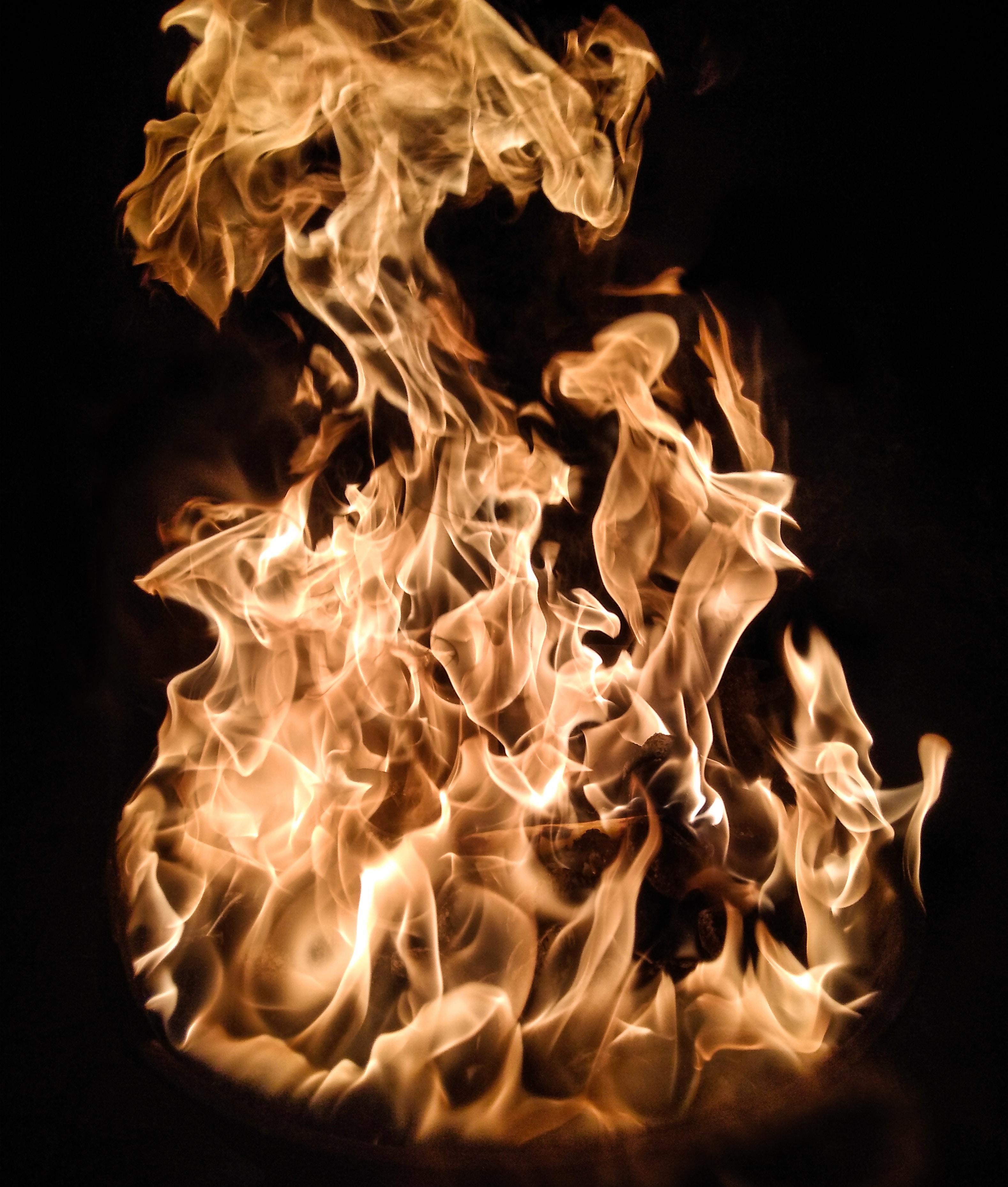 orange flame on black background