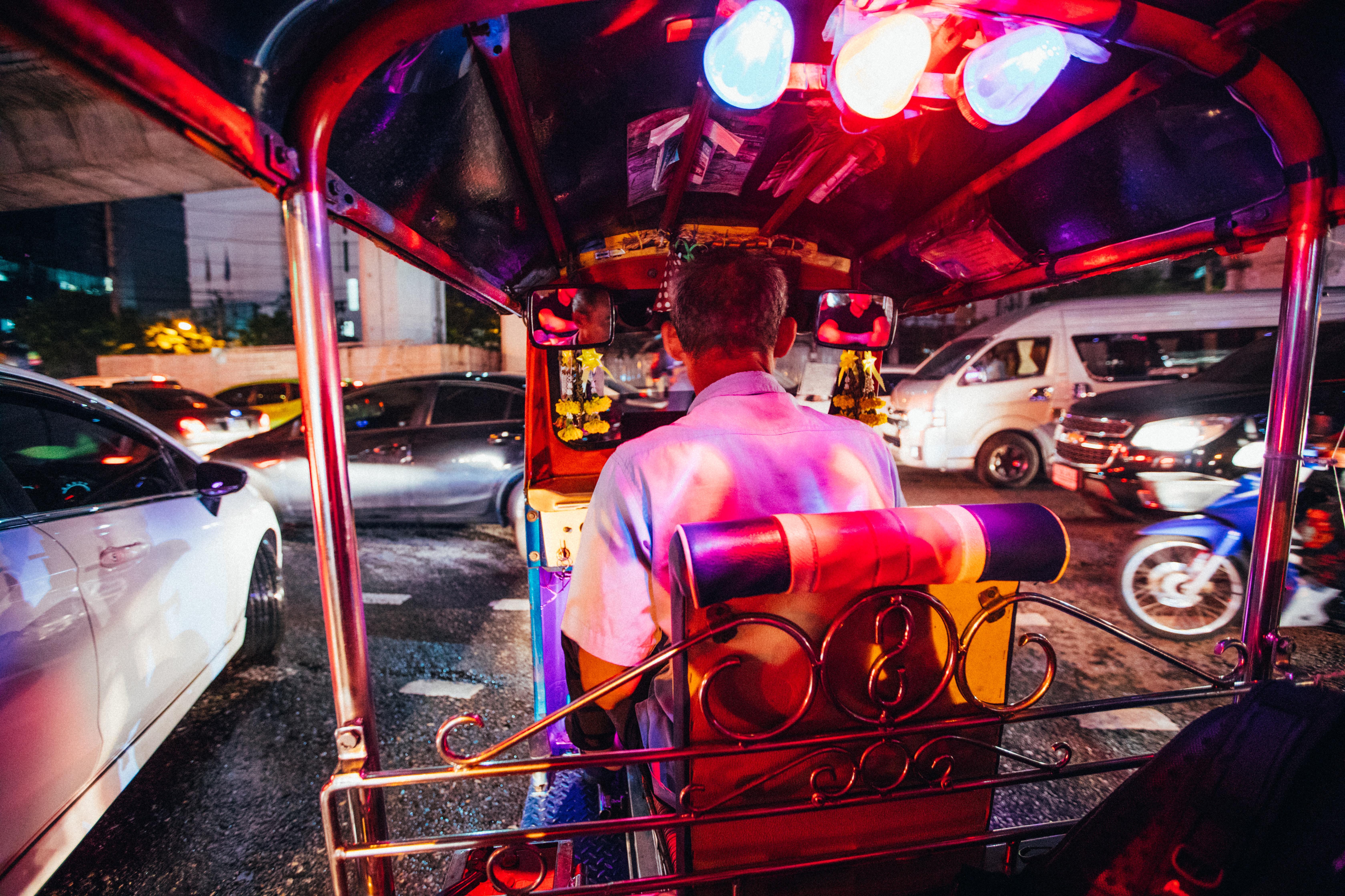 person driving auto-rickshaw