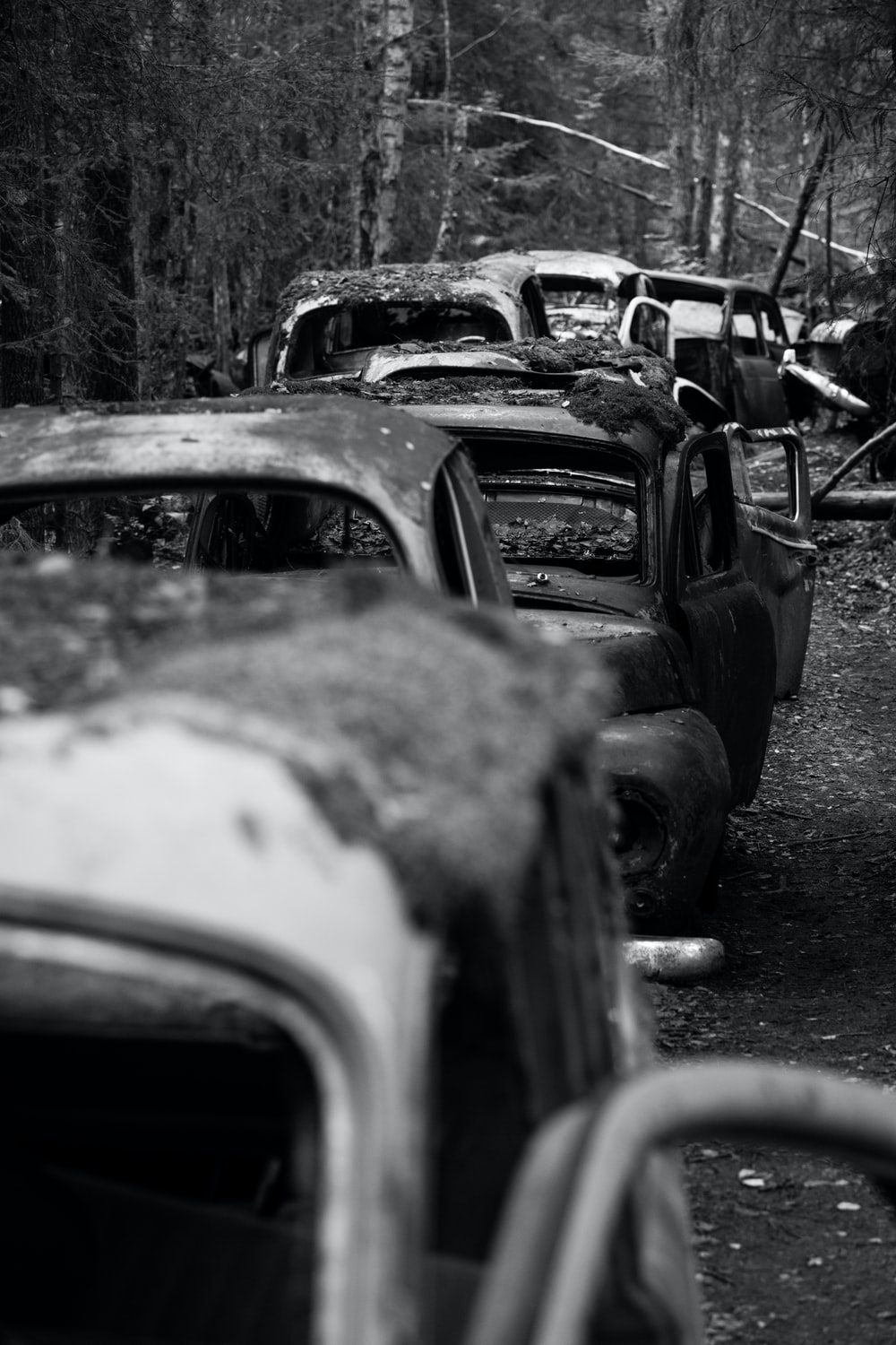 grayscale photography of wreck cars