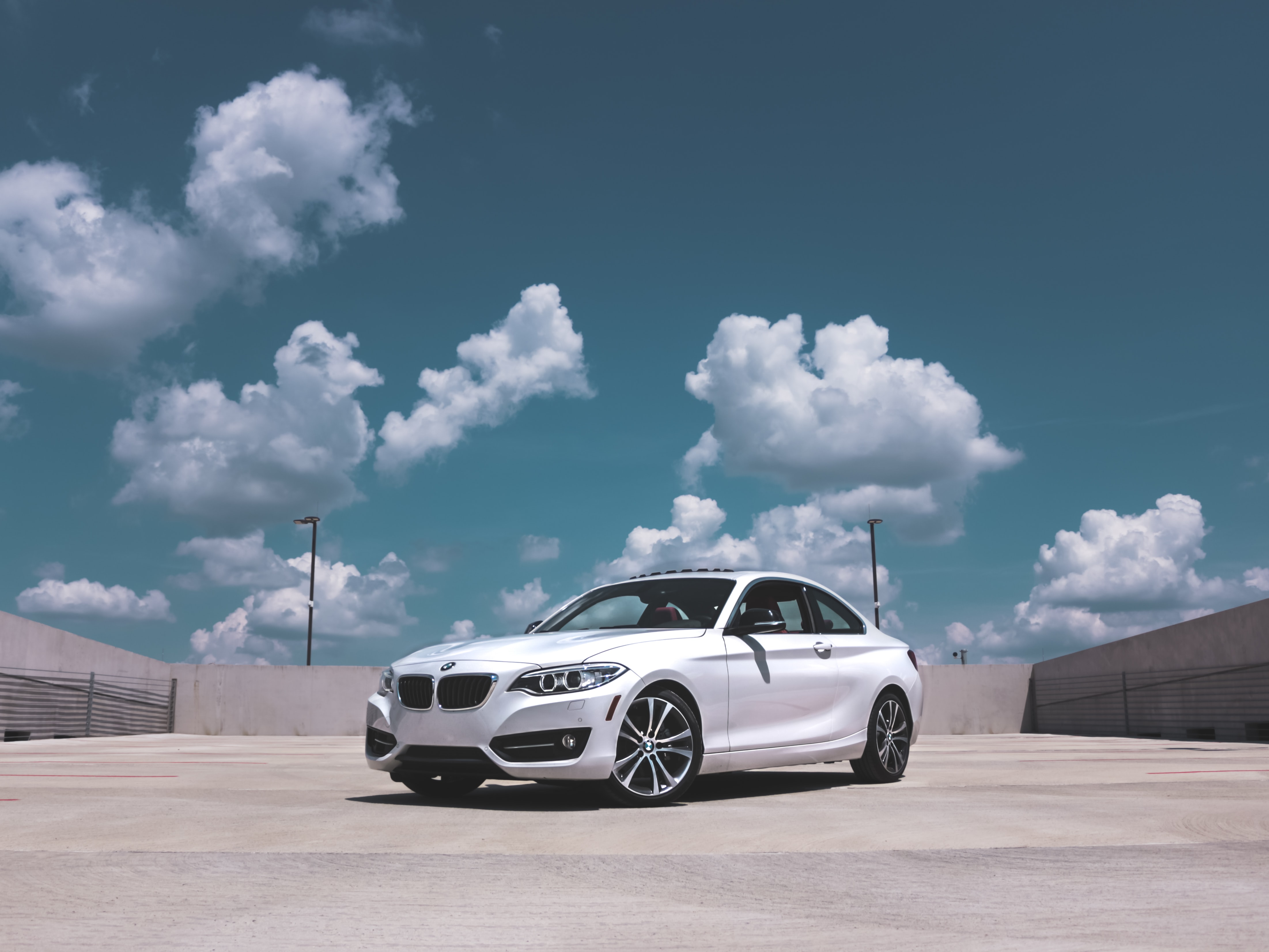 parked white BMW coupe