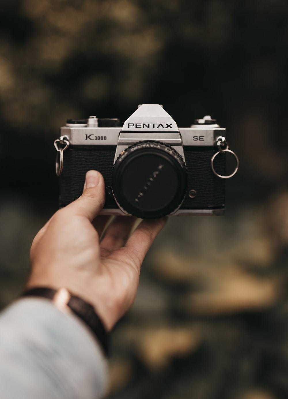 black and gray Pentax DSLR camera
