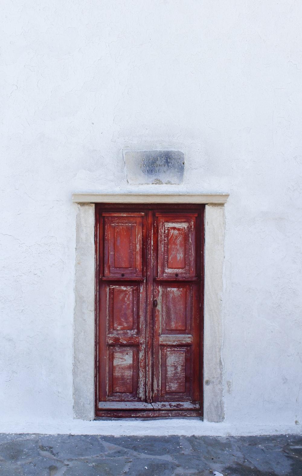 red wooden 6-panel door